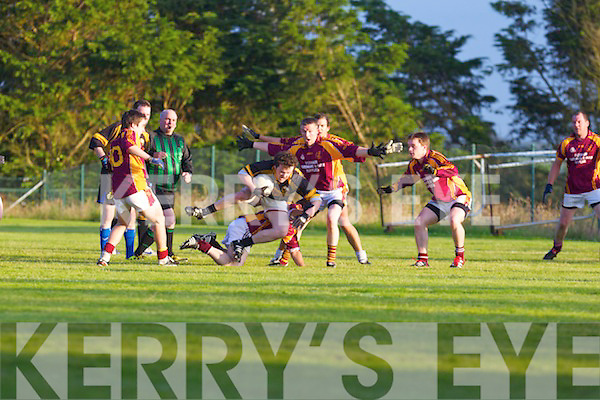Clounmacon's Seamus Twomey tries to gets break past Duagh's defence in the last moments of the Junior League Division 7 Final played last Friday in Moyvane.