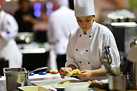 Melbourne, 30 May 2017 - Brooke Noble commis chef assisting Andrew Ballard of the Simmer Culinary in Mornington prepares potatoes at the Australian selection trials of the Bocuse d'Or culinary competition held during the Food Service Australia show at the Royal Exhibition Building in Melbourne, Australia. Photo Sydney Low