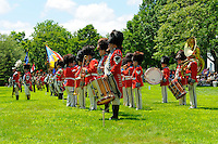 "Members of the Second Company, Governor's Foot Guard, Field Music Unit and Band, New Haven, Connecticut, at attention on Norwichtown Green in celebration of Samuel Huntington's birthday. Arguably the first president of the USA,  Huntington was president of Congress when the nation was first designated ""United States"" in the Articles of Confederation."