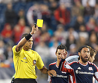 Yellow Card: New England Revolution midfielder Lee Nguyen (24) from Ismail Elfath In the first game of two-game aggregate total goals Major League Soccer (MLS) Eastern Conference Semifinal series, New England Revolution (dark blue) vs Sporting Kansas City (light blue), 2-1, at Gillette Stadium on November 2, 2013.