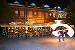 Fire Dancer Judith Eichenbaum AKA Kali of Los Angeles performs near the Rocco Restaurant Biergarten at the Hackeschermarkt Train Station, Berlin, Germany