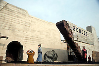 Actors reenact scenes from the Rape of Nanjing at the Nanjing Massacre Memorial Museum in Nanjing, Jiangsu, China, on the 71st anniversary of the events.
