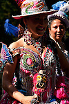 A woman dressed in a pink and gold costume represents Bolivia in the Hispanic Parade in New York City
