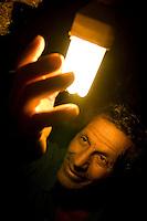 Juiz de Fora_MG, Brasil...Homem beneficiado pela eletrificacao rural segurando uma lampada acesa...A man benefit from the rural electrification holding a lamp lit...Foto: LEO DRUMOND / NITRO