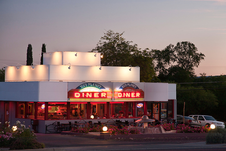 Red Planet Diner glows an eerie neon red in the evening in Sedona, Arizona
