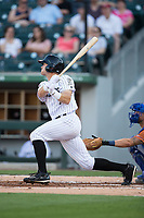 Adam Engel (7) of the Charlotte Knights follows through on his swing against the Durham Bulls at BB&T BallPark on May 16, 2017 in Charlotte, North Carolina.  The Knights defeated the Bulls 5-3. (Brian Westerholt/Four Seam Images)