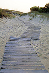 A boardwalk provides access to an Atlanic Ocean beach.