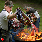 WATERTOWN, CT 06/14/04 061404JW01.JPG -- American Legion Post 195 Senior Vice Commander Tom Wisausky and Commander of the Sons of the American Legion Brian Whiteman  dispose of old flags during  a Flag Day ceremony at the Legion post in Watertown Monday afternoon. JONATHAN WILCOX PHOTO