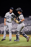 Mobile BayBears relief pitcher Ryan Clark (28) celebrates with catcher Michael Barash (16) at the end of a game against the Mississippi Braves on May 7, 2018 at Trustmark Park in Pearl, Mississippi.  Mobile defeated Mississippi 5-0.  (Mike Janes/Four Seam Images)