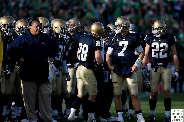 10/17/09 - South Bend, IN:  Notre Dame quarterback Jimmy Clausen (7) looks at head coach Charlie Weis during their game against USC at Notre Dame Stadium on Saturday.  USC won the game 34-27 to extend its win streak over Notre Dame to 8 games.  Photo by Christopher McGuire.