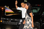 United States President Barack Obama and first lady Michelle Obama wave to well-wishers before boarding Air Force One for the return flight to Washington at Joint Base Pearl Harbor-Hickam on Saturday January 5, 2013 in Honolulu, Hawaii..Credit: Kent Nishimura / Pool via CNP
