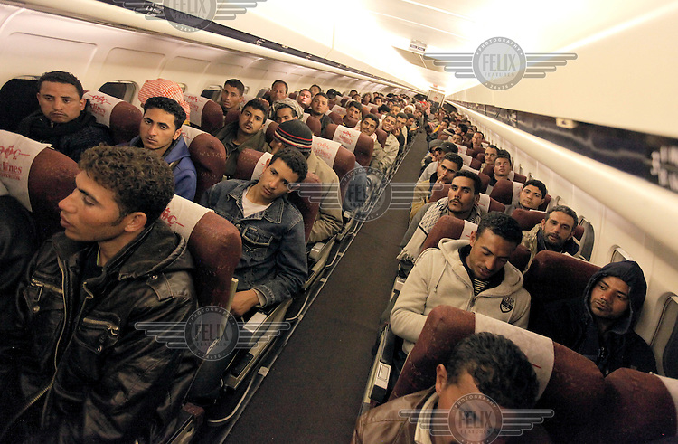 A group of Egyptians flown from Tunisia to Egypt by the French government. .Tens of thousands of people, mainly migrant workers, fled unrest in Libya and crossed the border into Tunisia. Some slept in the open for several days before being processed.  At the same time forces loyal to Col. Gaddafi fought opposition forces in various parts of the country.