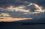 Clouds over La Gomera at dusk, Photograph taken from, Canary Islands. Spain. Inter Island ferry ship to the left of the picture.  April 2007
