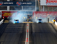 Feb 23, 2018; Chandler, AZ, USA; NHRA funny car driver Tim Wilkerson (left) does a burnout alongside Jonnie Lindberg during qualifying for the Arizona Nationals at Wild Horse Pass Motorsports Park. Mandatory Credit: Mark J. Rebilas-USA TODAY Sports