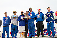 The Valle Catholic Boys stand on the podium with their 4th place team trophy at the State Cross Country Championships in Jefferson City, Saturday, November 3.