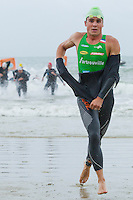 17 SEP 2011 - LA BAULE, FRA - Javier Gomez (EC Sartrouville) leaves the water at the end of the swim during the final round of the men's French Grand Prix Series at the Triathlon Audencia in La Baule, France (PHOTO (C) NIGEL FARROW)
