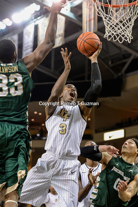 December 17, 2013 - Orlando, FL, U.S: Central Florida guard Isaiah Sykes (3) drives to the basket during 2nd half mens NCAA basketball game action between the Jacksonville Dolphins and the UCF Knights. UCF defeated Jacksonville 104-64 at the CFE Arena in Orlando, Fl.