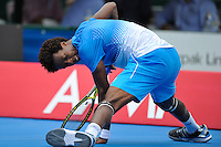 MELBOURNE, 12 JANUARY - Gael Monfils (FRA) recovers from slipping in a match against Fernando Verdasco (ESP) on day one of the 2011 AAMI Classic at Kooyong Tennis Club in Melbourne, Australia. (Photo Sydney Low / syd-low.com)