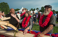 NWA Democrat-Gazette/BEN GOFF @NWABENGOFF<br /> Gomez Zackious (from left), school resource officer at Lakeside Junior High, Bill Mills, a teacher at Central Junior High, and Mill's parents Lucretia Richardson and Mike Davis, look at the finished KorKor canoe Friday, May 25, 2018, during the opening ceremony for the 39th annual Republic of the Marshall Islands Jemenei (Constitution) Day celebration at the Jones Center in Springdale. Zackious, who has Marshallese and Hawaiian ancestry, was the impetus behind building the KorKor, a type of Marshallese canoe. Zackious reached out to the Arkansas Coalition of Marshallese and the Shiloh Museum of Ozark History to make it possible. The sycamore tree selected for the build was donated by Davis and Richardson from their property in Alpena. The family was seeing the finished KorKor for the first time during the Jemenei celebration. The celebration continues Saturday with basketball, baseball and other sporting events.
