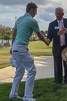Matt Fitzpatrick (ENG) shakes hands with the Arnold Palmer Invitational tournament leadership near 18 following round 4 of the Arnold Palmer Invitational at Bay Hill Golf Club, Bay Hill, Florida. 3/10/2019.<br /> Picture: Golffile | Ken Murray<br /> <br /> <br /> All photo usage must carry mandatory copyright credit (© Golffile | Ken Murray)