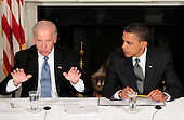 """Washington, DC - June 8, 2009 -- United States President Barack Obama, right, listens to Vice President Joseph Biden, left, report on the """"Roadmap to Recovery"""" during a meeting with his Cabinet, Washington, DC, Monday, June 8, 2009..Credit: Aude Guerrucci - Pool via CNP"""
