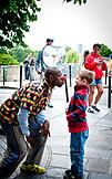 FRANCE, Paris, a Street Clown with a little boy outdoors