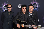 LOS ANGELES, USA. November 25, 2019:  Mike Dirnt, Billie Joe Armstrong, Tre Cool & Green Day at the 2019 American Music Awards at the Microsoft Theatre LA Live.<br /> Picture: Paul Smith/Featureflash