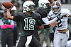 Aaron Ruthman #12, Elmont quarterback, throws a pass during a Nassau County Conference II varsity football game against Garden City at Elmont High School on Saturday, Oct. 1, 2016. He threw for three touchdowns in defeat as Garden City won 49-20.