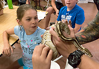 Jayla Pintus reacts to &quot;Fluffy&quot; a ball python owned and shown by SPCA animal cruelty officer Ryan Sparks, of Sarnia during a <br /> Critter Camp&rdquo;at the Sarnia Humane Society shelter. Upwards of 30 children intended the one week program under the direction of cruelty officer Becky Knight. The kids were treated to a visit from a veterinarian who did mock operations on stuffed animals, animal rescue workers, an exotic sale presentation and capped off with a trip to the animal farm and pizza.<br /> <br /> PD Day Camps for the 2017/2018 school year <br /> <br /> Becky Knight