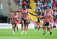 Lincoln City's John Akinde, centre, celebrates scoring the opening goal from the penalty spot<br /> <br /> Photographer Chris Vaughan/CameraSport<br /> <br /> The EFL Sky Bet League Two - Lincoln City v Swindon Town - Saturday 11th August 2018 - Sincil Bank - Lincoln<br /> <br /> World Copyright &copy; 2018 CameraSport. All rights reserved. 43 Linden Ave. Countesthorpe. Leicester. England. LE8 5PG - Tel: +44 (0) 116 277 4147 - admin@camerasport.com - www.camerasport.com