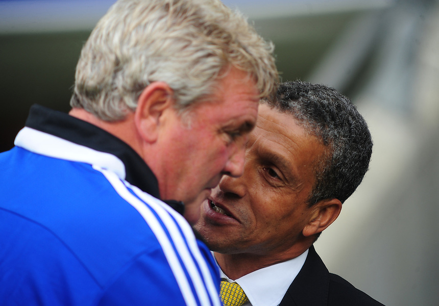 Hull City's Manager Steve Bruce, left, and Norwich City manager Chris Hughton before kick off<br /> <br />  (Photo by Chris Vaughan/CameraSport) <br /> <br /> Football - Barclays Premiership - Hull City v Norwich City - Saturday 24th August 2013 - Kingston Communications Stadium - Hull<br /> <br /> &copy; CameraSport - 43 Linden Ave. Countesthorpe. Leicester. England. LE8 5PG - Tel: +44 (0) 116 277 4147 - admin@camerasport.com - www.camerasport.com