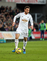 SWANSEA, WALES - FEBRUARY 07: Angel Rangel of Swansea moves forward during the Premier League match between Swansea City and Sunderland AFC at Liberty Stadium on February 7, 2015 in Swansea, Wales.