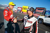 Feb 11, 2019; Pomona, CA, USA; NHRA top fuel driver Steve Torrence (right) congratulates race winner Doug Kalitta during the Winternationals at Auto Club Raceway at Pomona. Mandatory Credit: Mark J. Rebilas-USA TODAY Sports