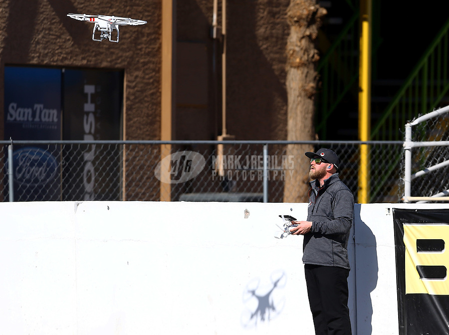 Feb 4, 2016; Chandler, AZ, USA; Don Schumacher Racing employee Kyle Cunningham flies a radio controlled drone quadcopter during pre season testing at Wild Horse Pass Motorsports Park. Mandatory Credit: Mark J. Rebilas-USA TODAY Sports