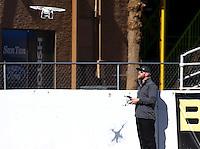 Feb 4, 2016; Chandler, AZ, USA; Don Schumacher Racing employee Kyle Cunningham flies a radio controlled drone quadcopter during pre season testing at Wild Horse Pass Motorsports Park. Mandatory Credit: Mark J. Rebilas-USA TODAY Sports