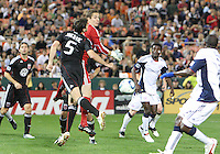 Troy Perkins #23 and Dejan Jakovic #5 of D.C. United let the ball slip to Kheli Dube #11 of the New England Revolution during an MLS match on April 3 2010, at RFK Stadium in Washington D.C.