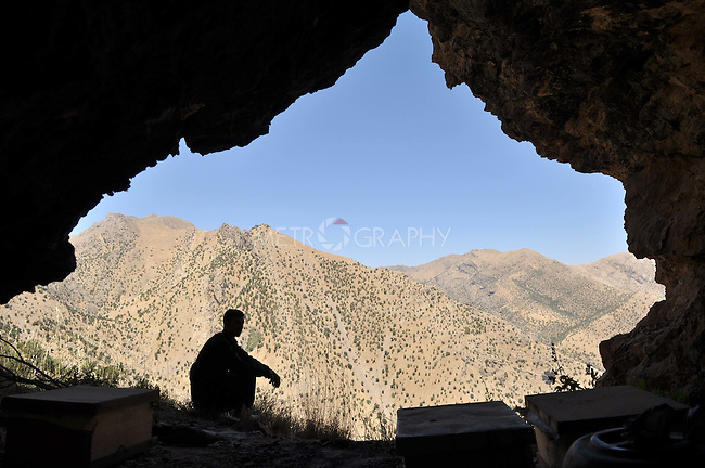 GALALA, IRAQ: Mohammad Abdul Rahman rests from the heat in a mountain cave.  Mohammad Abdul Rahman collects tree sap to make into traditional Kurdish chewing gum.<br /> <br /> Bnysht, a Kurdish is chewing gum made from the sap of the Daraban tree.  The sap is only harvested during July and August for 6 weeks using clay cups to catch the liquid as it is drawn for the tree's bark.<br /> <br /> Photo by Aram Karim