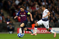 Lionel Messi of FC Barcelona and Harry Winks of Tottenham Hotspur during Tottenham Hotspur vs FC Barcelona, UEFA Champions League Football at Wembley Stadium on 3rd October 2018
