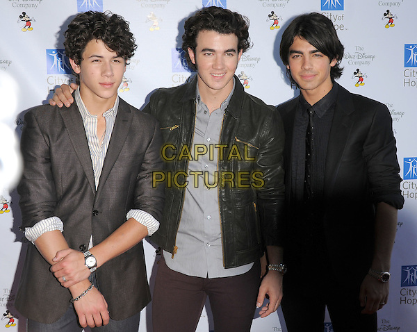 THE JONAS BROTHERS - NICK, KEVIN & JOE JONAS .At Disney's Concert for Hope, a benefit concert supporting City of Hope cancer research and treatment programs held at Universal Ampitheatre in Universal City, California, USA..September 14th, 2008.half length black grey gray suit jacket siblings family leather .CAP/DVS.©Debbie VanStory/Capital Pictures.