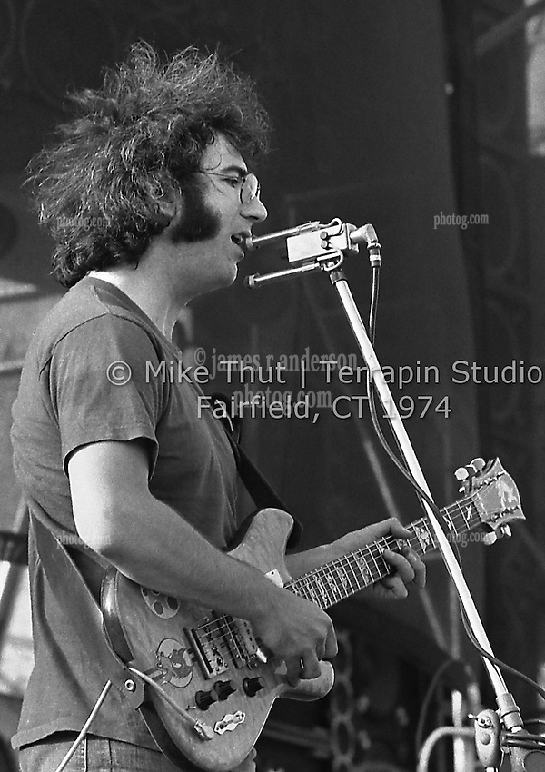 Jerry Garcia singing and playing Guitar with The Grateful Dead at Dillon Stadium in Hartford CT on 31 July 1974. Close in sidelong shot. Wall of Sound behind Jerry. Photo by Michael Thut, Fairfield CT.