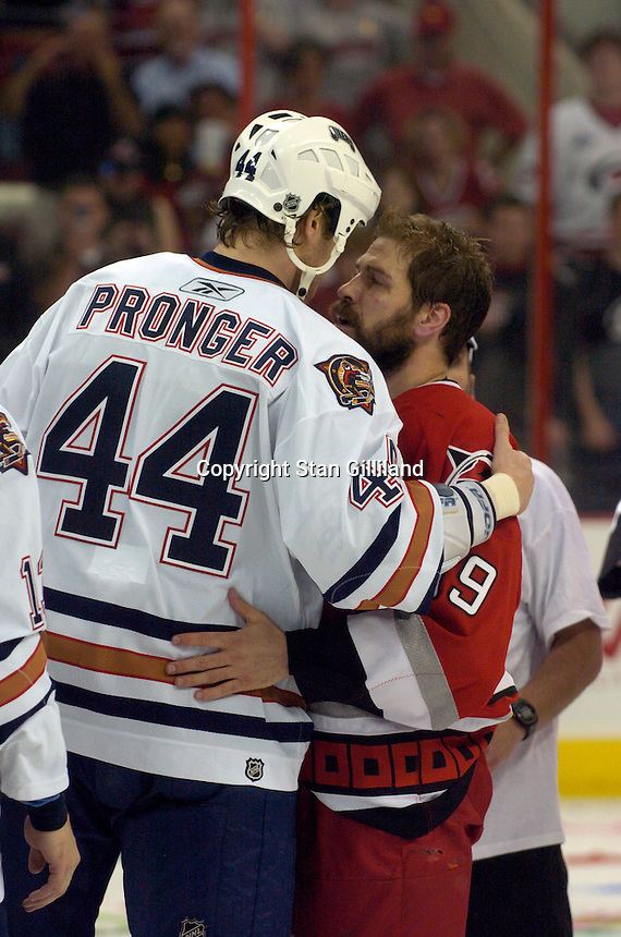 The Carolina Hurricanes beat the Edmonton Oilers 3-1 in game seven to take the Stanley Cup at the RBC Center in Raleigh, NC Monday, June 19, 2006. Here Edmonton's Chris Pronger congratulates former teammate Doug Weight of Carolina.