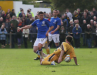 Fraser Aird beats Graeme Grant as he goes to ground in the Forres Mechanics v Rangers William Hill Scottish Cup 2nd Round match, at Mosset Park, Forres on 29.9.12.