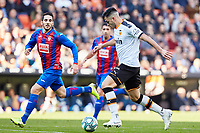 4th January 2020; Mestalla, Valencia, Spain; La Liga Football,Valencia versus Eibar; Maxi Gomez of Valencia CF shoots and scores the first goal for his team in minute 28' as he is challenged by Pedro Bigas of Eibar