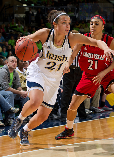 Feb 11, 2013; Kayla McBride (21) dribbles around Louisville Cardinals guard Bria Smith (21) in the second half at the Purcell Pavilion. Notre Dame won 93-64...Photo by Matt Cashore/University of Notre Dame