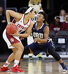 SIOUX FALLS, SD - MARCH 7:  Jasmine Trimboli #5 of South Dakota is defended by Jordan Doyle #2 of Oral Roberts in the 2016 Summit League Tournament. (Photo by Dick Carlson/Inertia)