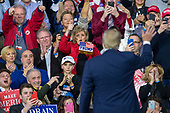 United States President Donald J. Trump leaves the stage during a Make America Great Again campaign rally at Atlantic Aviation in Moon Township, Pennsylvania on March 10th, 2018. Credit: Alex Edelman / CNP