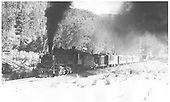 Leased D&amp;RGW K-27 #463 with work train of outfit cars and a caboose leaving Placerville.<br /> RGS  Placerville, CO  Taken by Perry, Otto C. - 6/11/1942