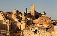 Buttresses of the Cathedral of Saint Mary of Tortosa, and Castle of Sant Joan or La Suda, Tortosa, Tarragona, Spain. The Catalan Gothic cathedral, on the left, was begun in 1347 and consecrated 1597. The 10th century Castle of Sant Joan was built by Muslim Caliph Abd ar-Rahman III. It was conquered in 1148 and became residence of the Montcada and Knights Templar, then a royal mansion from the 13th century. Picture by Manuel Cohen
