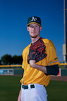 AZL Athletics Gold Chase Wheatcroft (50) poses for a photo before an Arizona League game against the AZL Rangers on July 15, 2019 at Hohokam Stadium in Mesa, Arizona. The AZL Athletics Gold defeated the AZL Rangers 9-8 in 11 innings. (Zachary Lucy/Four Seam Images)