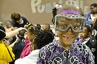 J`nessa Hughs (7) of New Hope Elementary, Columbus, MS, shows off her safety goggles while her classmates try on other types of protective clothing at the College of Veterinary Medicine open house..<br />
